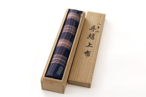 新垣幸子作 八重山手縞上布「紺地赤格子に絣」着尺のサブ6画像